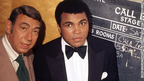 "Muhammad Ali is photographed with Howard Cosell backstage before ""The Muhammad Ali Variety Special"" in July of 1975."