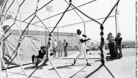Frank Robinson takes a few swings during batting practice in this undated photo. He was the first African American to manage a team in the major league.