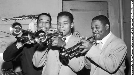 Clark Terry plays the trumpet with his son Rudolph and Duke Ellington in 1955.