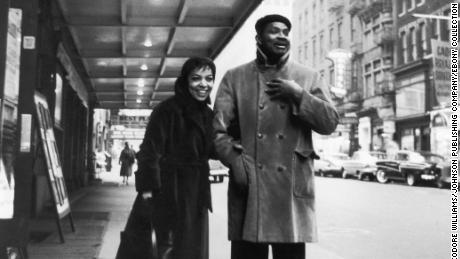 Ruby Dee and Ossie Davis stand outside of a theater in 1959.
