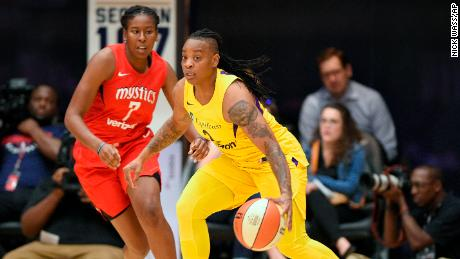 Los Angeles Sparks guard Riquna Williams, right, dribbles against Washington Mystics guard Ariel Atkins.