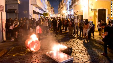 Protesters who filled the street in front of the governor's mansion in Old San Juan clashed with the police.