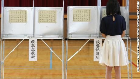 A woman casts her vote at a polling station in Japan. Sunday's upper house election could see a dramatic increase in the number of female lawmakers.
