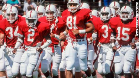 PALO ALTO, CA 1989: Cory Booker # 81 and his Stanford Cardinal teammates jog on the field during warmups before a football game during the 1989 season at Stanford Stadium in Palo Alto, California. Other visible players include Scott Eschelman # 34, Alan Grant # 2, Kevin T. Scott # 3, and Gary Taylor # 15