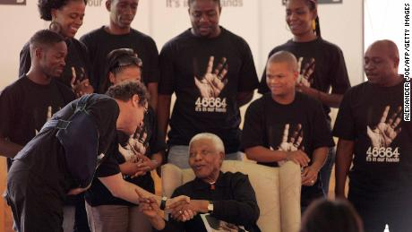 South Africa's former President Nelson Mandela poses with Johnny Clegg on Oct. 29, 2007.