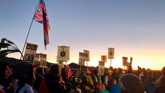 Demonstrators gather to block a road at the base of Hawaii's tallest mountain on July 15, 2019, in Mauna Kea, Hawaii, to protest the construction of a giant telescope on land that some Native Hawaiians consider sacred.