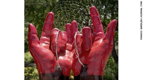 The Spider-Man hands sculpture is part of a public art project sponsored by a nonprofit.
