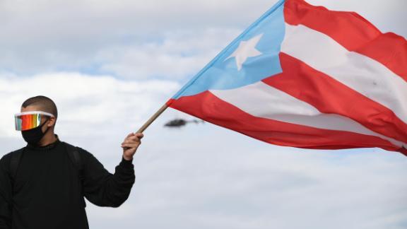 Reggaeton Singer Bad Bunny joins a protest in San Juan, Puerto Rico on Wednesday.