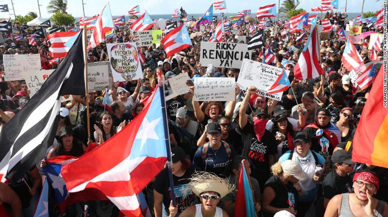 Protesters rallied Wednesday in front of the capitol building in Old San Juan, Puerto Rico.