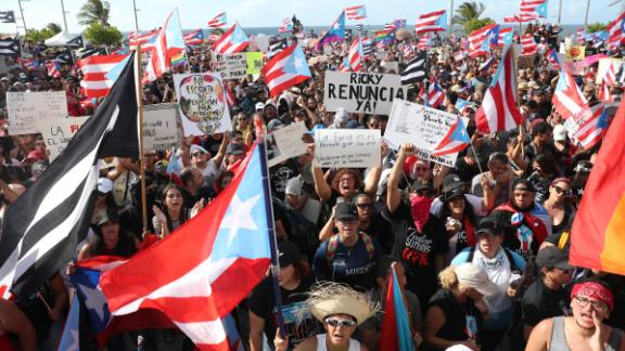 Demonstrators protest outside Puerto Rico's Capitol Building in Old San Juan on Wednesday.