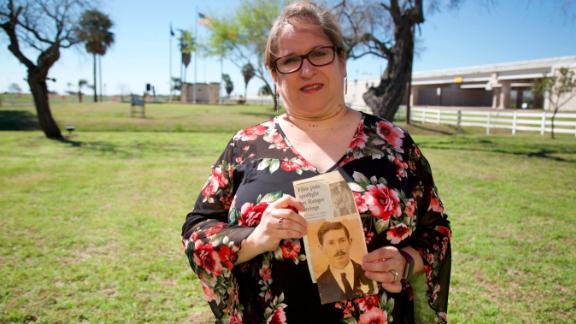 Christine Molis holds a photo of her slain relative.