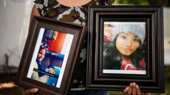 Jessica Gámez Garcia holds photos of her niece Heydi Nallely Gámez Garcia in the backyard of a home in Bay Shore, Long Island, NY on July 17, 2019.