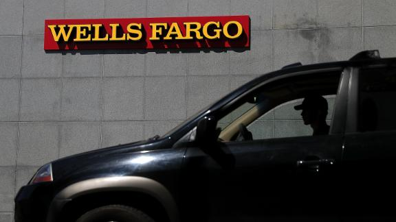 SAN RAFAEL, CA - APRIL 13:  A car sits parked in front of a Wells Fargo bank office on April 13, 2018 in San Rafael, California. Wells Fargo reported better than expected first quarter earnings with a profit of $5.94 billion but may need to update the results as investigations into the bank's auto loans and mortgages that could cost $1 billion to resolve. (Photo by Justin Sullivan/Getty Images)