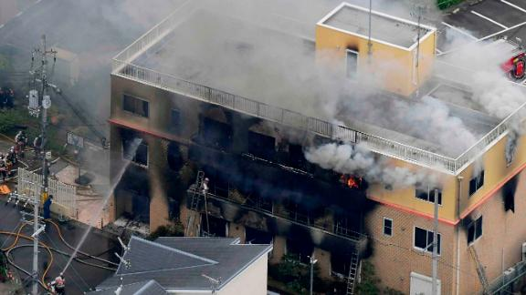 Smoke billows from a three-story building of Kyoto Animation in a fire in Kyoto, western Japan, Thursday, July 18, 2019. Kyoto prefectural police said the fire broke out Thursday morning after a man burst into it and spread unidentified liquid and put fire.(Kyodo News via AP)