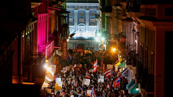 Thousands of demonstrators protest in front of the governor's mansion on July 17.