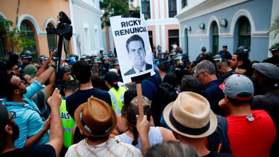 OLD SAN JUAN, PUERTO RICO - JULY 14: Police block the street leading to the Governors mansion on July 14, 2019 in Old San Juan, Puerto Rico. Protesters are calling on Gov. Rossello to step down after a group chat was exposed that included misogynistic and homophobic comments. The signs reads Ricky resign. (Photo by Jose Jimenez/Getty Images)