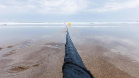 Part of the Marea cable, funded by Microsoft and Facebook, running out to the ocean. The cable runs across the Atlantic between Virginia, US and Bilbao, Spain.