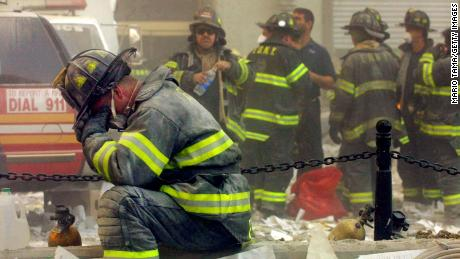 A firefighter breaks down after the World Trade Center buildings collapsed September 11, 2001 after two hijacked airplanes slammed into the twin towers in a terrorist attack.