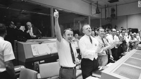 Three of the four Apollo 13 Flight Directors applaud the successful splashdown of the Command Module