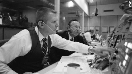 Gene Kranz (left) and Chris Kraft at their consoles.
