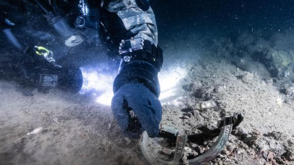 A team of eight divers searched for four years before finally locating the submarine hunter.