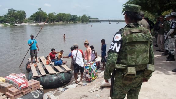 National guard members stand guard along the banks of the Suchiate river in Ciudad Hidalgo, Chiapas State, Mexico, on July 3, 2019. (Photo by STR / AFP)