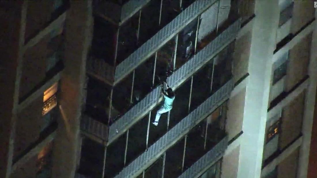 """A man escaped a high-rise on fire by climbing down it in true """"Spider-Man"""" style"""