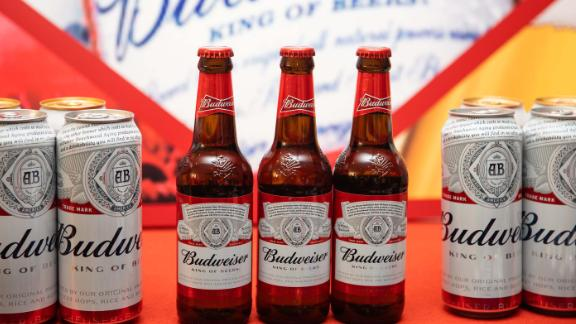 Budweiser beer products manufactured by Anheuser-Busch InBev NV sit on display during a news conference in Hong Kong, China, on Thursday, July 4, 2019. Jan Craps, chief executive officer of Budweiser Brewing Company APAC Ltd., poses for photos during a news conference in Hong Kong, China, on Thursday, July 4, 2019. The IPO of Budweiser Brewing Company APAC, which is set to raise as much as $9.8 billion in Hong Kong later this month, will give AB InBev more flexibility to seek local partners, Chief Executive Officer Jan Craps said at a press conference in Hong Kong. Photographer: Kyle Lam/Bloomberg via Getty Images