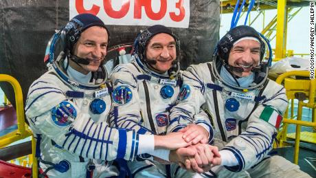 At the Baikonur Cosmodrome in Kazakhstan, Expedition 60 crew members Drew Morgan of NASA, Alexander Skvortsov of the Russian space agency Roscosmos and Luca Parmitano of ESA (European Space Agency) pose for pictures July 5, 2019, in front of their Soyuz MS-13 spacecraft during prelaunch preparations. They will launch July 20, 2019 from Baikonur for their mission on the International Space Station.