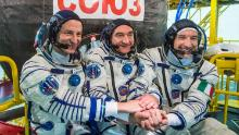 Expedition 60 crew members Andrew Morgan of NASA, Aleksandr Skvortsov of the Russian space agency Roscosmos and Luca Parmitano of ESA in front of their Soyuz MS-13 spacecraft in July 2019.
