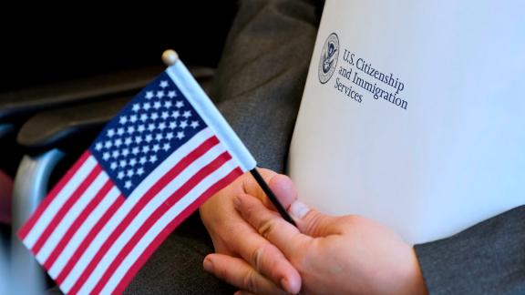 SALT LAKE CITY, UT - APRIL 10: An applicant holds an American flag and a packet while waiting to take the oath to become a U.S. citizen at a Naturalization Ceremony on April 10, 2019 in Salt Lake City, Utah. There were 49 people from 26 countries that became U.S. citizens. A group of Republican Senators are introducing a bill today to reduce legal immigration in the United States. (Photo by George Frey/Getty Images)