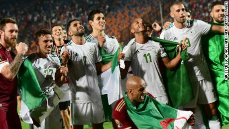 Algerian players celebrate with their fans after winning the 2019 Africa Cup of Nations.