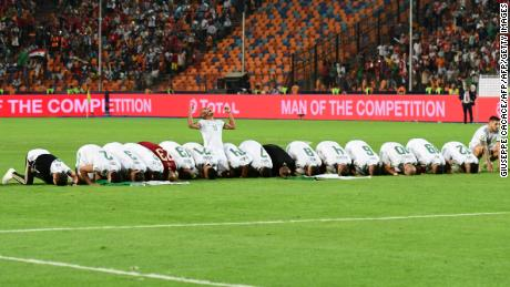 Algerian players pray as they celebrate after winning the 2019 Africa Cup of Nations.