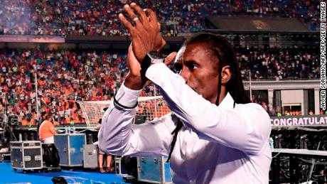 Senegal coach Aliou Cisse applauds the traveling fans after the defeat.