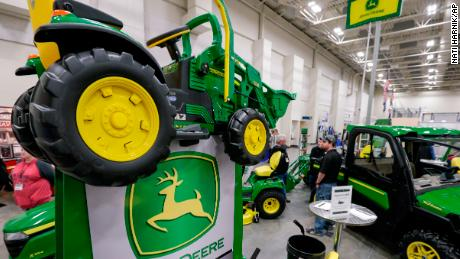 A toy tractor is seen among John Deere products in this file photo from February 2018.