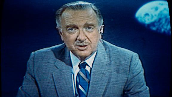 Walter Cronkite speaks during the Apollo 11 mission, broadcast by CBS-TV, July 1969. Photo made from television screen. (AP Photo)