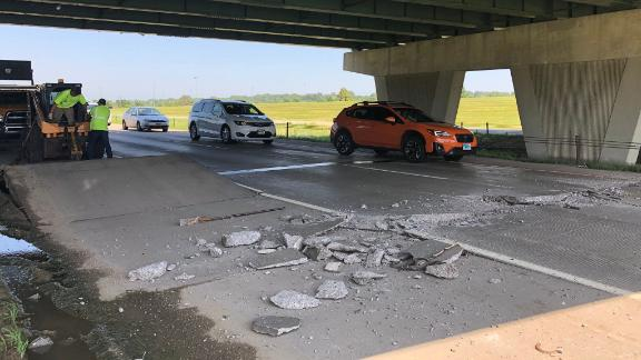 Vehicles drive over a buckled road, caused by the heat, on Interstate 229 under the Western Avenue bridge in Sioux Fall, South Dakota, on July 19.