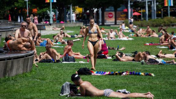People sunbathe at Pier 45 in New York on Saturday, July 20.
