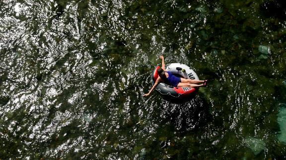 A woman floats in a tube on the Comal River, in New Braunfels, Texas, on July 18.