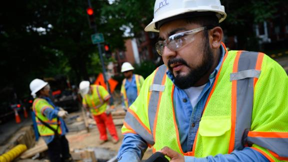 Albert Tapia, 29, a foreman for PowerComm Construction, Inc., works at a construction site on 13th Street in Washington, DC, on July 18.
