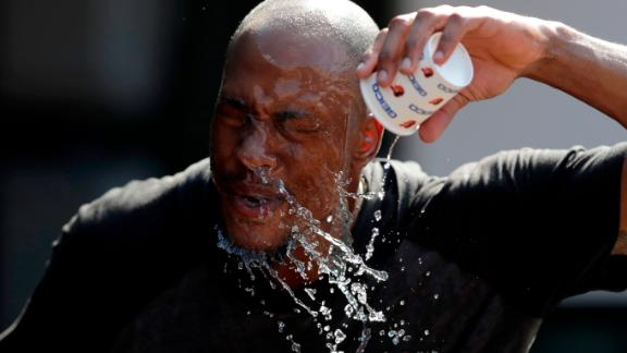 Baltimore Orioles outfielder Keon Broxton douses himself with water prior to a baseball game against the Boston Red Sox in Baltimore, Maryland, on Friday, July 19.
