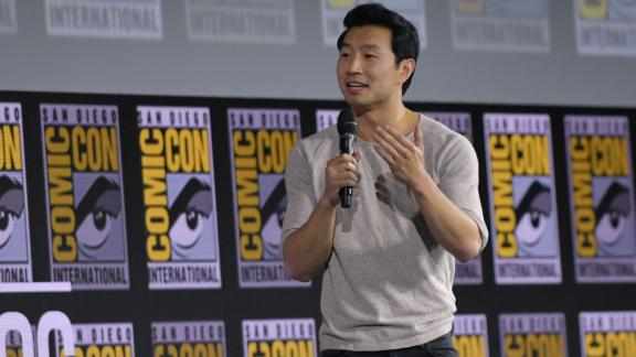 Simu Liu speaks on stage for the Marvel panel at  Comic-Con on Saturday. (Photo by Chris Delmas / AFP)