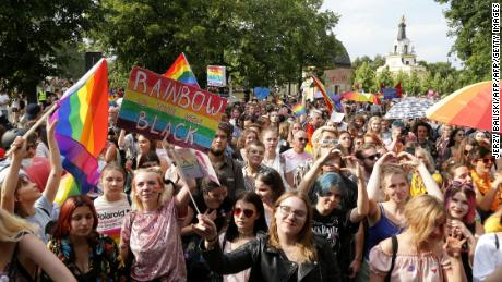 About 1,000 pride marchers walked defiantly through the city center as ultra-nationalist football hooligans and the far right attempted to block the march.