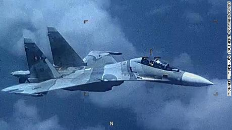 "Image of a Venezuela SU-30 Flanker as it ""aggressively shadowed"" a U.S. EP-3 Aries II at an unsafe distance in international airspace over the Caribbean Sea July 19, jeopardizing the crew and aircraft. The EP-3 aircraft, flying a mission in approved international airspace was approached in an unprofessional manner by the SU-30 that took off from an airfield 200 miles east of Caracas. The U.S. routinely conducts multi-nationally recognized and approved detection and monitoring missions in the region to ensure the safety and security of our citizens and those of our partners. (Released by U.S. Southern Command)"