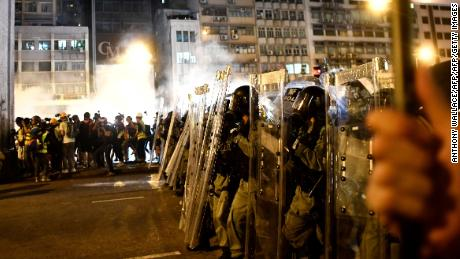 Police fire rubber bullets and tear gas in clash
