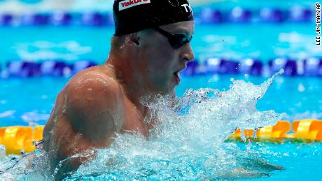 Britain's Adam Peaty broke his own record time in the men's 100-meter breaststroke semifinal at the World Swimming Championships in South Korea on Sunday.