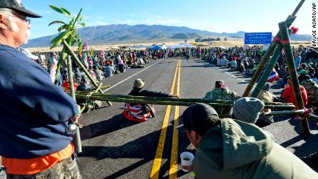 Protesters continue their vigil against the construction of the thirty-meter telescope at Mauna Kea on the Big Island of Hawaii on Friday, July 19, 2019.
