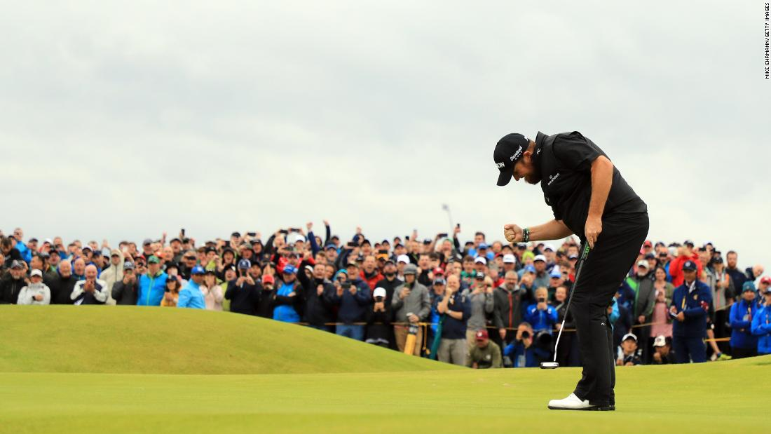 "Shane Lowry of Ireland reacts to his birdie putt on the 15th green during the final round of the 148th Open Championship held at Royal Portrush Golf Club in Portrush, Northern Ireland, on Sunday, July 21.<a href=""https://www.cnn.com/2019/07/21/sport/shane-lowry-open-championship-royal-portrush-final-day-spt-intl/index.html"" target=""_blank""> Lowry</a>, who led the tournament going into the final round, finished six strokes ahead of the field to win his first major championship.<br />"