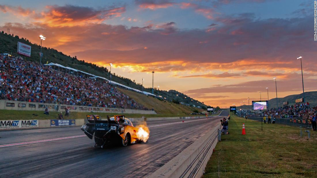 NHRA funny car driver J.R. Todd races at sunset during qualifying for the Mile High Nationals at Bandimere Speedway in Morrison, Colorado, on Friday, July 19.