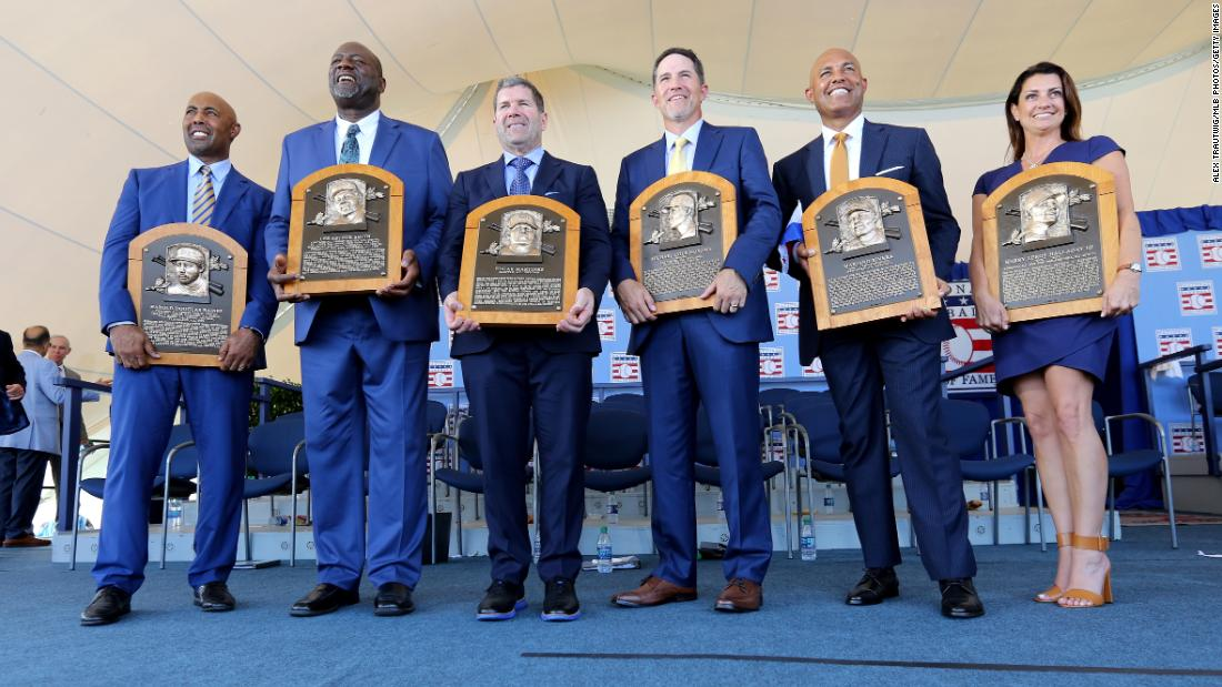 From left, Baseball Hall of Fame Inductees Harold Baines, Lee Smith, Edgar Martinez, Mike Mussina, Mariano Rivera and Brandy Halladay, the widow of the late Roy Halladay, pose for a photo following the Hall of Fame Induction Ceremony at the National Baseball Hall of Fame in Cooperstown, New York, on Sunday, July 21.